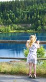 The girl at the mountain lake. The lake is a component of the hydrosphere, which is a naturally formed reservoir filled with water in the lake basin lake bed and royalty free stock images