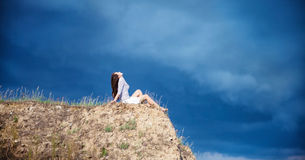 Girl on a mountain Stock Photos