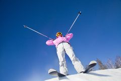 Girl on mountain skiing Stock Photos