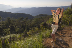 The girl on the mountain. At sunrise stock photos