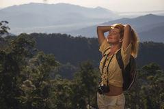 The girl on the mountain travel. The girl on the mountain at sunrise travel royalty free stock photo