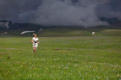 The girl in mountains Stock Photos
