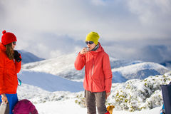 The girl in the mountains with coffee. royalty free stock image