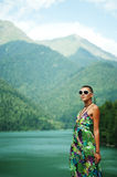 Girl in mountains on the lake Stock Photography
