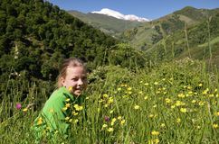 A girl on the mountains meadow, spring Pyrenees Royalty Free Stock Image