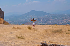 Girl and mountains. Royalty Free Stock Photography
