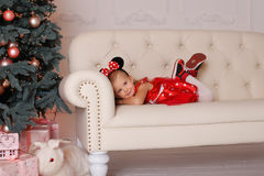 The girl in a mouse costume at Christmas Stock Photo