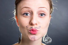 Girl with a moustache Stock Photos