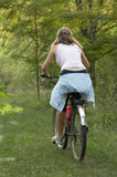 Girl moutain biking Stock Images