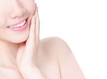 Girl mouth closeup with smile and hand touch face Stock Images