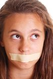 Girl with mouth taped Royalty Free Stock Images