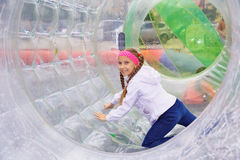 Girl moves inside the zorb Stock Image