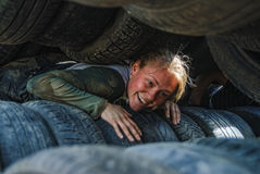 Girl moves between old tires. Tyumen Royalty Free Stock Images