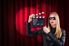 Girl with movie board Royalty Free Stock Photos
