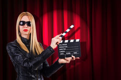 Girl with movie board Royalty Free Stock Photography