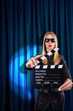 Girl with movie board Stock Images