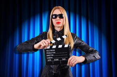 Girl with movie board Stock Photo