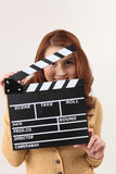 Girl with Movie Slate Royalty Free Stock Photography