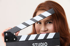 Girl with Movie Slate Stock Photography