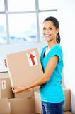 Girl moving in box Royalty Free Stock Images