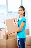 Girl moving in box Stock Photography