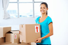 Girl moving in box Royalty Free Stock Photos