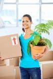 Girl moving in box Stock Photos