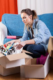 Girl moving flat Royalty Free Stock Images