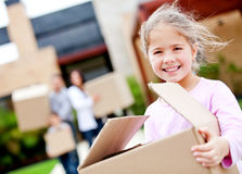 Girl moving house Royalty Free Stock Image