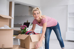 Girl moving in the new apartment stock images