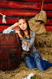 The girl on a mow. The little girl in a shed near to a butt, a photo in a retro style Stock Photography