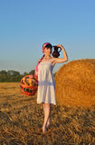 The girl on a mow with a basket of bread and a jug of milk Royalty Free Stock Photo