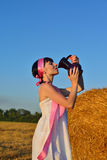 The girl on a mow drink a milk from jug Royalty Free Stock Photos