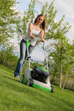 Girl Mows The Lawn Royalty Free Stock Photos