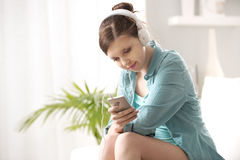 Girl with mp3 player Stock Images