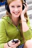 Girl with mp3 player Royalty Free Stock Photos