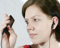Girl with Mp3-player royalty free stock photo