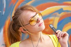 Girl with mp3-player Stock Images