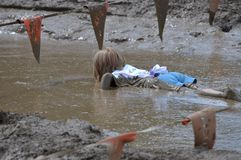 Girl in Mud. Little girl in mud Royalty Free Stock Image
