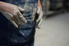 Girl with muddy hands. Mid section of girl with muddy hands stock photo