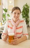 Girl  with mug of beer Royalty Free Stock Image