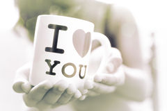 Girl with a mug meaning love Royalty Free Stock Photography