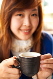 Girl and mug of tea Stock Photo