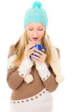 Girl with a mug and a winter hat Stock Photography