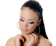 The girl the mulatto with a beautiful make-up. The girl the mulatto with beautiful make-up on white Stock Photo