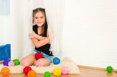 Girl with multi-colored balls Royalty Free Stock Image
