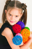 Girl with multi-colored balls. The image of the girl with multi-colored balls Royalty Free Stock Image