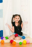 Girl with multi-colored balls. The image of the girl with multi-colored balls Stock Images