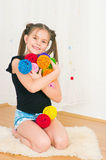 Girl with multi-colored balls. The image of the girl with multi-colored balls Royalty Free Stock Photo
