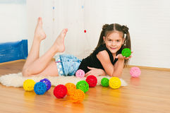 Girl with multi-colored balls. The image of the girl with multi-colored balls Stock Photos